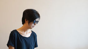 Short hair cool Asian woman with hipster look, wearing casual sh royalty free stock photos