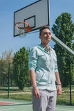 Short hair girl in a basketball playground Royalty Free Stock Photo