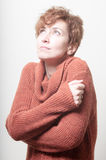 Short hair girl cold with orange sweater Royalty Free Stock Images