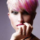 Short HAir Girl. Colorful Dyed Hair. Short HAir Girl. Beauty Fashion Model Girl with Colorful Dyed Hair. Woman with perfect Makeup and Hairstyle. Rainbow stock photo