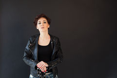 Short hair girl in glasses and fancy leather jacket Stock Images