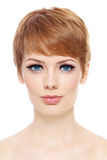 Short haircut. Portrait of young beautiful woman with stylish short haircut over white background royalty free stock image