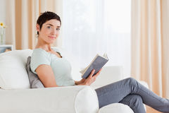 Short-haired brunette holding a book Stock Photos