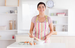 Short-haired brunette woman preparing a cake Stock Photo