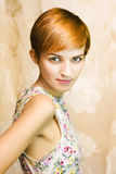 Short haired girl in floral dress Royalty Free Stock Photos