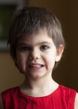 Short-haired girl. A short-haired four-year-old girl in a red top Royalty Free Stock Photo