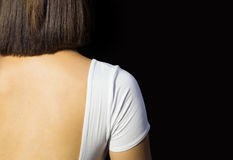 Short haired woman showing her back Stock Image