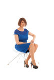 Short haired woman sitting on transparent chair Royalty Free Stock Image