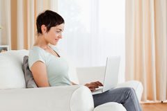 Short-haired woman working with a laptop Royalty Free Stock Photo
