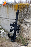 Airsoft rifle. In the short intervals between games, the airsoft rifles are resting while the players are reloading Royalty Free Stock Photo
