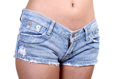 Short jeans. Closeup image of young woman in short jeans on white background Stock Images