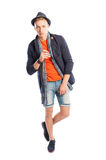 Short jeans and elegant suit jacket with scarf and hat Stock Image