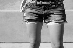 Short jeans. Girl wearing short jeans, casual outfit Royalty Free Stock Photography