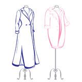 Short and long coat female mannequins dressed in the made in thu. Mbnail style on a white background Royalty Free Stock Images