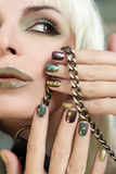 Short manicure brown green. Royalty Free Stock Photography