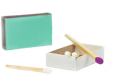 Short matches in a box. And one violett coloured on top of it Stock Photo