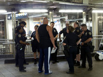 Short meeting before the shift NYPD. Short meeting of policemen in New York in a subway station Stock Image