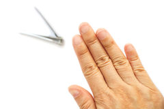 Short nails of woman& x27;s hand. Clean and short finger& x27;s nails. Woman cutting nails on white background. Healthcare, cleaning lifestyle Royalty Free Stock Images