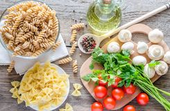 Short pasta with mushrooms and cherry tomatoes Royalty Free Stock Photography
