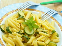 Short pasta penne with zucchini and mint Stock Photos