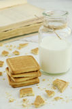 Short pastry and bottle of milk. On light background stock photography