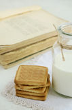 Short pastry and milk bottle on vintage doily Stock Image