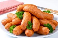 Short pork sausages Stock Images