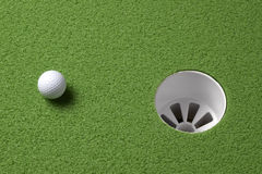 Short putt. Close up shot of a golf ball a few inches from the hole with space for copy Stock Photography