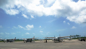 Short range planes ready for passengers at Philip S. W. Goldson Airport in Belize Royalty Free Stock Image