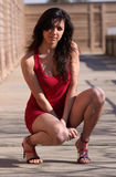 Short red dress. Young woman posing in short red dress Royalty Free Stock Photo