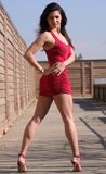 Short red dress. Young woman posing in short red dress stock photography