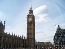 A short and remote glance at Big Ben and the Houses of Parliament near the river Thames in London in April t. A short and remote glance at Big Ben and the House Stock Images