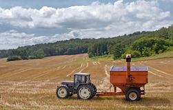 A short rest. A tractor in a field, ready to plant corn for the next season Royalty Free Stock Photography
