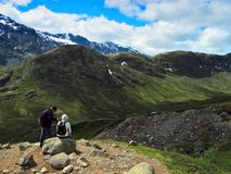 Short rest among mountains. Man and woman have a rest among mountains. Jotunheimen national park, Norway Royalty Free Stock Photo