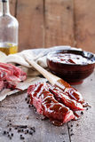 Short Ribs and Barbecue Sauce. Country ribs with barbecue sauce and basting brush over a rustic table Royalty Free Stock Photo