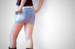 Short Skirt. A close up on a woman in a short skirt on a white background Stock Image