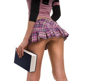 Short skirt and a book Stock Photo
