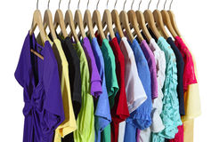 Short Sleeve Clothes. Short Sleeve female clothes on hanger isolated over white Stock Photos