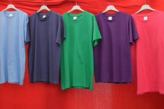 Short sleeve cotton t-shirts. In various colors for sale at street market Royalty Free Stock Image