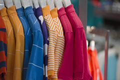 Short sleeves polo shirt on display stand Stock Photo