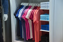 Short sleeves polo shirt on display stand Stock Images