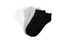 Short socks isolated. Three pairs of black, grey and white short socks isolated on wite background Royalty Free Stock Photo