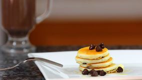 A short stack of dollar size pancakes with chocolate chips. Royalty Free Stock Photos