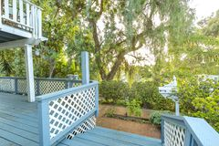 Short stairs leading out the entry way of a cottage style home i. Nto the garden near sunset. Patio area of beautiful southern California home in San Diego Royalty Free Stock Photos
