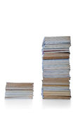 Short and tall. Book stack over the white background Stock Image