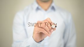 Short Term,  Man writing on transparent screen. High quality Royalty Free Stock Photo
