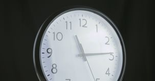 A short time lapse of a clock face.  stock footage