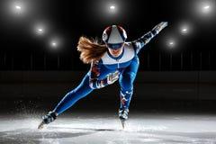 Short track athlete on ice. Preparing to start royalty free stock photography