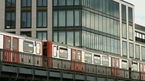 Hamburger Hochbahn. A short train of the Hamburger Hochbahn, an above street level tram system, passing by stock video