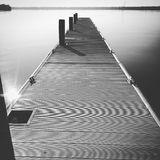 Short walk down a long pier?. Black and White of pier on the St. Johns River, Fl in Palatka, Fl royalty free stock image